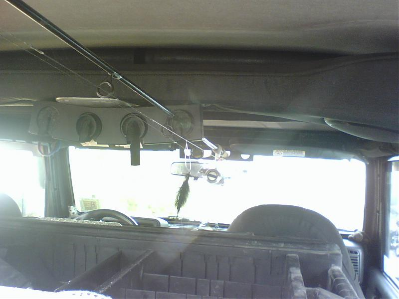 Jeep wrangler rod rack page 2 car interior design for Jeep fishing rod holder